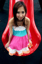Cute Asian girl on a slide Royalty Free Stock Images