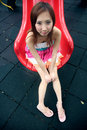 Cute Asian girl on a slide Stock Photo
