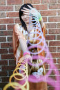 Cute Asian girl with slinky toys Royalty Free Stock Photo