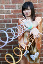 Cute Asian girl with slinky toys Royalty Free Stock Photography