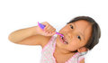 Cute asian girl and toothbrush Royalty Free Stock Photos