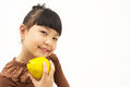 Cute asian kid with a quince isolated on white background Royalty Free Stock Photos