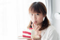 Cute Asian teenager holding strawberry cake Royalty Free Stock Photo