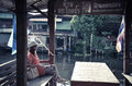 Cute asian thai girl is relaxing in pavilion near he riverside the vintage color style the language say no fishing and no Royalty Free Stock Photos