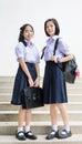 Cute Asian Thai high schoolgirls student couple standing Royalty Free Stock Photo