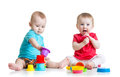 Cute babies playing with color toys. Children girl Royalty Free Stock Photo