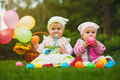 Cute babies are playing on the green grass kids Royalty Free Stock Photography