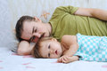 Cute baby ailing with daddy and lying sad Stock Photo