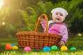 Cute baby in basket in the green park is playing Stock Photo