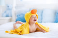 Cute baby after bath in yellow duck towel Royalty Free Stock Photo