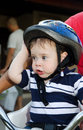 Cute baby with bicycle helmet a blue Stock Images