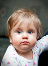 Cute baby with blue eyes portrait of girl blond hair and Royalty Free Stock Photo