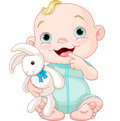 Cute baby boy adorable holding bunny toy Royalty Free Stock Photography