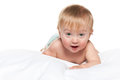 A cute baby boy in the bed on the white background Royalty Free Stock Image