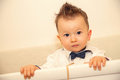 Cute baby boy with bow tie fancy haircut and Royalty Free Stock Photos
