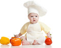 Cute baby boy chef with healthy  food vegetables Stock Photo