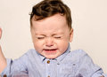 Cute baby boy crying. Royalty Free Stock Photo