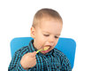 Cute baby boy eating with green spoon Royalty Free Stock Photo
