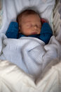 Cute baby boy fast asleep inside his crib Stock Images