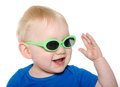 Cute baby boy with green sunglasses month old blond hair and blue shirt wearing on white background Royalty Free Stock Photo