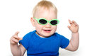 Cute baby boy with green sunglasses month old blond hair and blue shirt wearing on white background Stock Photos