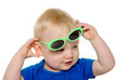 Cute baby boy with green sunglasses month old blond hair and blue shirt wearing on white background Royalty Free Stock Photos