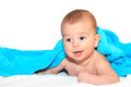 Cute baby boy lying down isolated covered with blue towel close up in white Stock Images