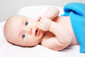 Cute baby boy lying down and looking into camera. Royalty Free Stock Photo