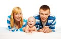 Cute baby boy with parents little laughing laying in the bed Stock Image