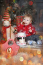 Cute baby boy playing with christmas tree decoration in studio Royalty Free Stock Photo
