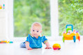 Cute baby boy playing with colorful ball and toy car