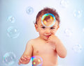 Cute baby boy playing with soap bubbles Royalty Free Stock Photography