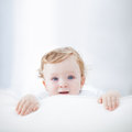Cute baby boy a playing on the sofa Royalty Free Stock Photos