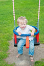 Cute baby boy playing on swing Royalty Free Stock Photo