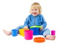 Cute baby boy plays with buckets Royalty Free Stock Photo