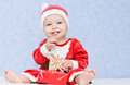 Cute baby boy santa helper on a blue background Royalty Free Stock Photos