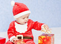Cute baby boy santa helper on a blue background Royalty Free Stock Images