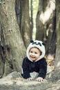 Cute baby boy wearing a Panda bear suit Royalty Free Stock Photo