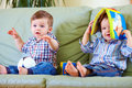 Cute baby boys playing with toys at home Stock Photos