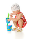 Cute baby with bucket and spade Stock Photo