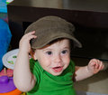 Cute baby with a cap funny posing big Stock Images