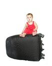 Cute baby child with a suitcase Royalty Free Stock Photo