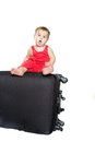 Cute baby child with a suitcase Stock Image