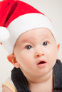 Cute baby with christmas cap portrait of a Stock Images