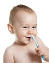 Cute baby cleaning teeth and smile Royalty Free Stock Photos