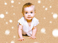 Cute baby crawls with snow Royalty Free Stock Photography
