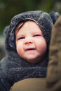 Cute baby dressed for winter making funny face Stock Photos