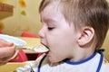 Cute baby eat porridge Royalty Free Stock Photo