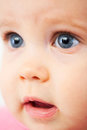 Cute baby face with blue eyes looking curious Royalty Free Stock Photos