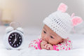 Cute baby girl and alarm clock wake up in the morning Royalty Free Stock Images